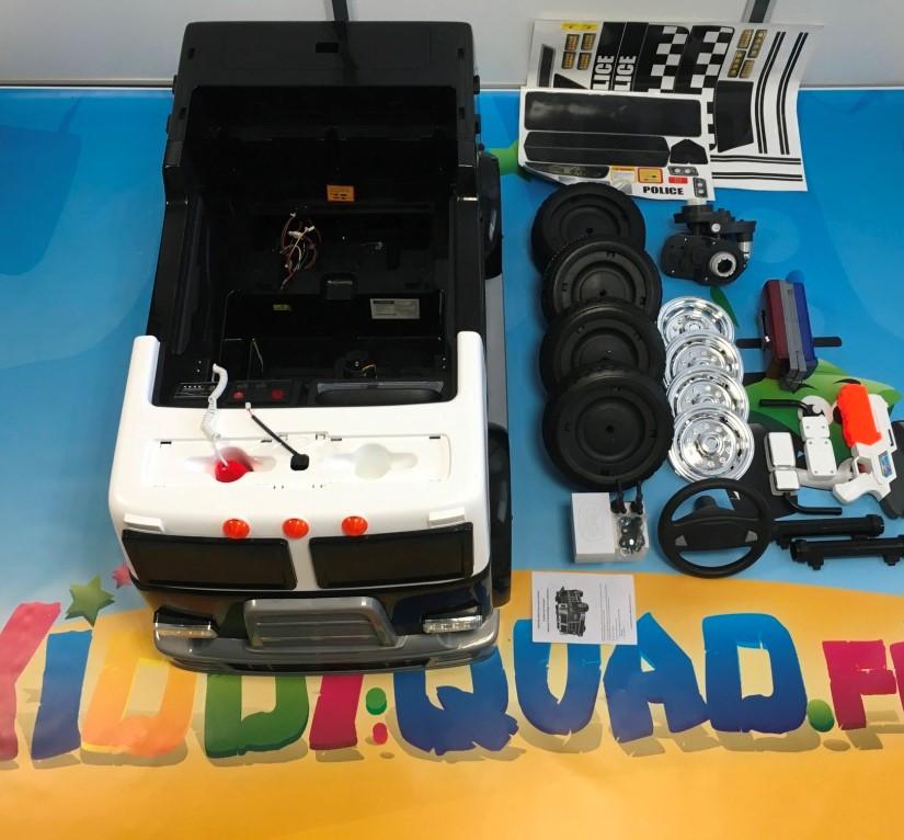 déballer votre camion de police 24 volts pour enfant